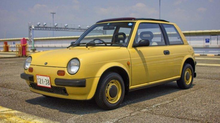 1989 Nissan Be-1, sárga hatchback, elölnézet balról
