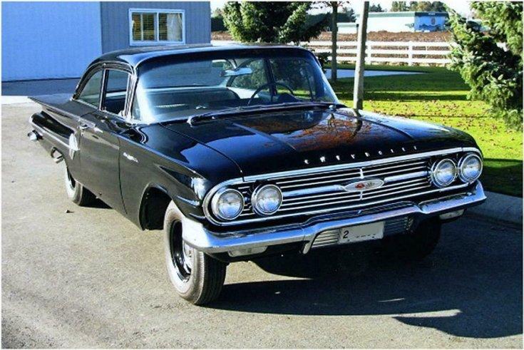 1960 Chevy Bel Air, fekete kupé, elöl jobbról