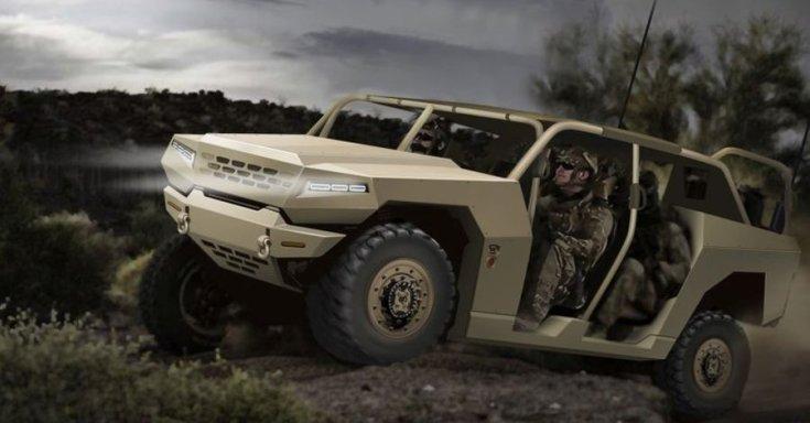 A Kia katonai célokra szánt Hummer szerű terepjárója a terepen, féloldalról
